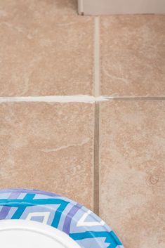 Make your tiled floor look brand new again! This tutorial has the easiest tips and tricks to paint your tile grout with just a few simple steps. Avoid the hassle of cleaning your dirty grout lines and find the best paint products to freshen up your grout. Grout Paint, Sanded Grout, Tile Grout, Cleaning Floor Grout, Grout Repair, Easy Tile, Stain Techniques, Painting Tile Floors, How Do You Clean