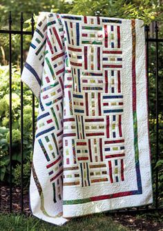 Brightly colored fabrics weave through a white background in this cleverly designed quilt. Make the quilt blocks in sets of nine, seven, and six to replicate the woven structure. This quilt, Weavers by Tony Jacobson, is fat-quarter friendly.