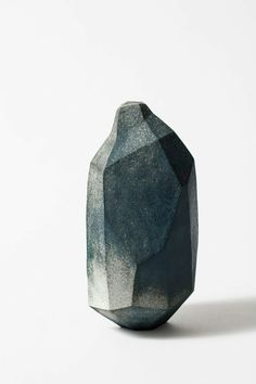 Polygonal form, stone, rock, minimal sculpture, minimalist inspiration ideas, modern, contemporary abstract art sculpture, carved stone, smoked, burned