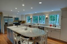 Wow! Lovely Windows and look at that counter space! Love the scones and the decorative moulding!