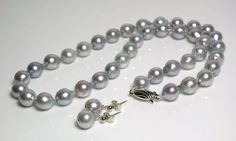 Isis Pearls - Grey-blue 8-9mm baroque Akoya pearl 9 carat gold necklace & earrings