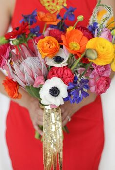 Brides.com: 20 Ways to Wrap a Wedding Bouquet. Say Yes to Sequins. This bold bouquet by Primary Petals pops with color thanks to oversized anemones, king protea, ranunculus and poppies. The sequin ribbon amps up the glam factor. Other design elements from this wedding, styled by Carly Rae Weddings, mirror incorporate sequin details as well.  See more photos from this modern wedding.