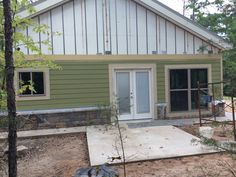 front of home view.. 5 ft French door and living room window on right and kitchen sink window on left