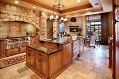 No stone wall. Colors. Floors, counter and cabinets. Like the stacked ceiling and darker trim.