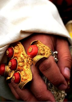Tibetan saddle rings in gold and coral.