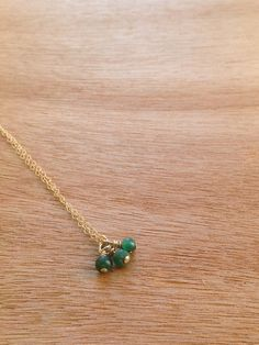 Three tiny jade beads on a 14k Gold Filled chain. This beautiful necklace is simple enough for everyday wear, yet elegant with a splash of color.
