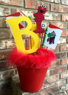 Hey, I found this really awesome Etsy listing at https://www.etsy.com/listing/265453052/sesame-street-centerpiece-elmo