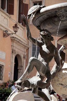 Rome, Italy--A charming architectural detail from the Fountain of the Tortoises, at the heart of Rome's Jewish Ghetto
