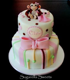 Beautiful baby shower girl cake, with stripes and monkey cake topper. www.SugarellaSweets.com