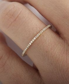 Tiny Diamond Eternity Band— maybe to replace the ring I lost? Not that I deser… Sponsored Sponsored Tiny Diamond Eternity Eternity Ring Diamond, Diamond Rings, Diamond Jewelry, Diamond Bracelets, Solitaire Diamond, Thin Diamond Wedding Band, Gold Jewelry, Simple Wedding Bands, Trendy Wedding