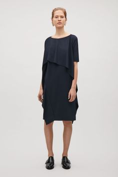 COS image 1 of Dress with draped layer in Navy