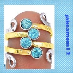 Two tone blue topaz ring Adorable two tone blue topaz ring set in Sterling silver Jewelry Rings