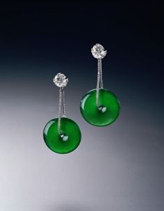 Jadeite earrings of exceptional translucency and of a very fine emerald green colour. Est.: HKD 2.8-3.8 mil