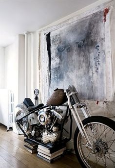 This is the home of Eva and Gentry Dayton in Brooklyn.   I love, love LOVE the vintage Harley Davidson in the living room !!!