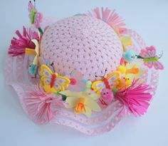 This easy Easter bonnet is great to do with kids. The bonnet is covered in flowers that are snipped from card and easily attached to the hat using double-sided tape.