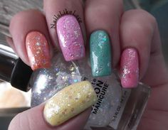 Pastel Skittles - thumb is China Glaze Lemon Fizz, pointer is China Glaze Peachy Keen, middle is Kleancolor Pastel Purple, ring is L.A. Colors Meadow, and pinkie is Zoya Sweet. They are all topped with 2 coats of the beautiful, iridescent glitter, Sally Hansen Snow Globe