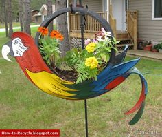 Recycled old tire made into the garden decoration of a bright and colorful bird. Description from pinterest.com. I searched for this on bing.com/images