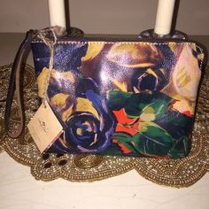 ‼️‼️ STUNNING COLORFUL WRISTLET by Patricia Nash‼️ Oh my gosh do I have to say anything about this wristlet really? I will say is made out of the best Italian leather as all of her things are! But the rich color is what makes this wristlet different than most! It's absolutely GORGEOUS!! Patricia Nash Bags Clutches & Wristlets