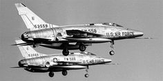 A pair of North American Super Sabre fighter jets with landing gear deployed. S/N Buzz Number in the foreground. Us Military Aircraft, Military Jets, Supersonic Speed, Aviation Image, Us Air Force, Korean War, War Machine, Planes, Fighter Jets