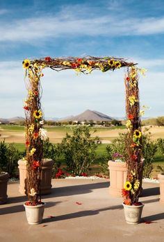 A rustic archway for a Western-themed wedding in the Arizona desert