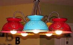 Colored colanders can be perfect repurposed decoration elements in the house. Here is another proof with this multiple pendant light. …