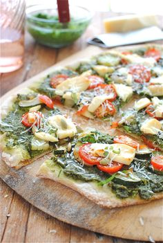 garden vegetable pizza with kale, pesto, garlic, zucchini, parmesan and brie