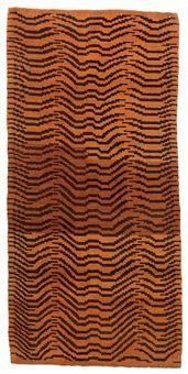 A TIBETAN TIGER RUG, early C20th, sold at Christie's 2010