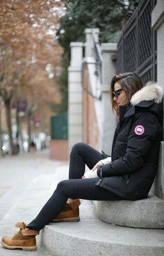 Timberlands are the perfect item to break up an all black winter outfit. Silvia Zamora wears this pair with black denim and a cool Canada Goose parka with a faux fur hood. Parka: Canada Goose, Jeans/Jumper: Zara, Sunnies: Céline. #Timberland #Fashion