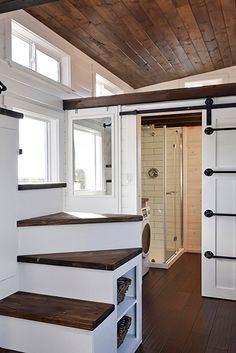 Like the bathroom layout The exterior has dark siding with white trim while the interior is the opposite with white washed knotty pine walls and dark wood accents. Small Tiny House, Tiny House Living, Tiny House Design, Tiny House On Wheels, Small Loft, Knotty Pine Walls, Wood Siding, Wood Paneling, Exterior Siding