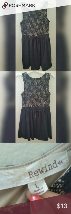 "Rewind Black Lace Bow Mini Dress Black Lace Rewind Mini Dress Size: Large Condition: Like new only worn once! *I'm 5'6"" and it stop about 4"" above my knee *Fabric not stretchy *65% Cotton  Thanks for taking a look at my closet! Rewind Dresses Mini"