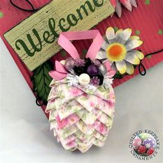 Handmade Pink Floral Quilted Pine Cone Ornament  Each scale on the pine cone is meticulously folded and pinned into place giving it that beautiful geometrical cone shape. This ornament is embellished with berries, and real pine cones and is ready to hang on your tree or ornament stand. A truly unique Christmas decoration for the holiday season! Give one as a gift or start your own quilted collection that you can enjoy year after year ♥  Ornament Size Appx. 4 tall  Made in a Smoke Free home