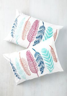 Night after night, these feather-printed pillowcases continue to inspire the sweetest dreams. Perhaps it's the teal, turquoise, peach, and magenta color scheme, or the soft cotton fabric of these coverings that enhance your slumber. Whatever it is, this case set makes bedtime reliably restful!