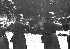 Einsatzgruppe shooting in the act of murdering civilian jews