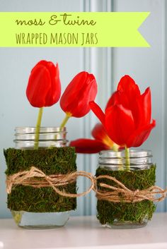 These little mason jars are so cute for spring! Wrapped in moss and twine, these are so easy to make and really brighten your spring decor!