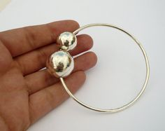handmade sterling silver bangle with two balls by BIZARREjewelry