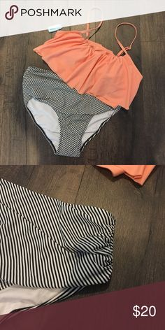 NWT 2 piece suit Bottoms are high waisted.  Still has tags and original packaging.  Comes from pet free, smoke free home. Swim