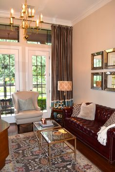 To accent the antique end tables and sofa we brought in a wingback chair, throw pillows, drapes, an antique brass chandelier and antique brass and glass bunching tables.
