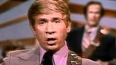 Buck Owens - Arms Full of Empty, via YouTube.