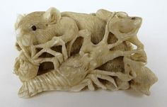 Description: A Japanese carved ivory group of rats, fish, seashells and a lobster 8cm wide
