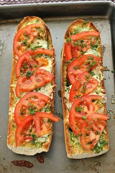 A crunchy and cheesy open faced grilled cheese sandwich with tomato.