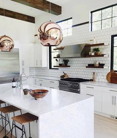 This Winter white kitchen is so fresh looking. It looks modern but also timeless. The pendants by @tomdixonstudios always pack a punch. See my Mandeville Canyon kitchen. Link in profile. Repost of @cestesdesign