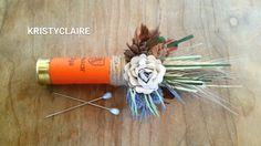 Rustic Orange Wildflower ShotGun Shell Boutonniere by KRISTYCLAIRE #wedding #bridalbouquet #paperflowers #champagne #boutonniere #hunting #shotgunshells #thistle #wheat #camouflage #grass #grasswedding #woodlandwedding #countrytheme #rusticwedding #rustic #country #buttonhole #twine #deer #camouflage #masculine #orange #fall #autumn #fallwedding #autumnwedding #pinecones #pinenuts #pineconewedding #fishing #fishingwedding #flyfishing #orangeshotgunshell #orangewedding