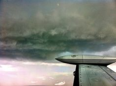 Below a Thunderstorm looking out the right wing of the Cessna 340.