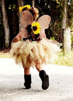 """Our Autumn fall fairy wings complete any fairy ensemble. Perfect to go with our fall tutus or tutu dresses. Fairy wings are a gorgeous chocolate brown color. Wings are adorned with a brown satin bow and topped with a yellow sunflower.       *Wings have stretchy satin loops that fit over arms.       *Fits best ages 6 months-5 years      Wings are 17x12"""""""