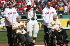 Jason Varitek, David Ortiz and Tim Wakefield (back, left to right) and Johnny Pesky and Bobby Doerr were among many Red Sox alumni who attended a pregame ceremony at Fenway Park to commemorate its 100th anniversary