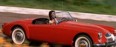 1959 MG A 1600 Roadster MkI Movie: Blue Hawaii The MG in Blue Hawaii was Chad Gates' (Elvis) car that his girlfriend Maile Duval drove to pick him up at the airport when he arrived home from the army.