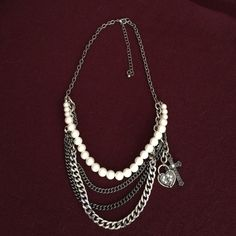 """Necklace Beautiful multi-stand necklace with heart, key, and cross charms. The charms have faux diamond embellishments. Stainless steel and pearl strands. The necklace measures 18"""" across with a 3"""" extender. Maurices Jewelry Necklaces"""