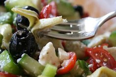Italian Vegetable Salad with artichokes, tomatoes, cukes, peppers, olives, and feta.