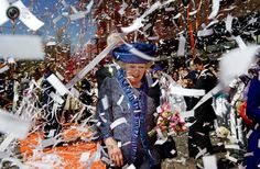 Queen Beatrix of the Netherlands walks in a ticker tape parade during the annual Queens' day in Veenendaal.