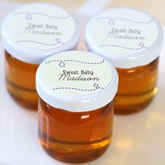 """Nothing's sweeter than a honeybee baby shower, and guests will love bringing home tiny little jars of honey as their shower favors. See how Courtney from Pizzazzerie personalized the jars she gave away at the """"Sweet as Can BEE"""" baby shower she styled, and how the favor blended seamlessly with the rest of the bee-themed décor."""